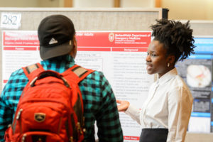 Nia Cayenne (right) presents her research project to attendees at the Undergraduate Symposium hosted in Varsity Hall at Union South at the University of Wisconsin-Madison on April 13, 2017. The annual event showcases student-led research, creative endeavors and service-learning projects. (Photo by Bryce Richter / UW-Madison)