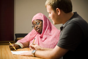 Samaa Abdurraqib (left), an instructor at the University of Wisconsin-Madison writing center, provides help to a student on July 16, 2008. Photo by: Bryce Richter
